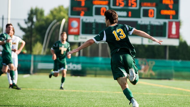 Vermont's Eamon Kitson (13) celebrates a goal during the men's soccer game between the La Salle Explorers and the Vermont Catamounts at Virtue Field last September.