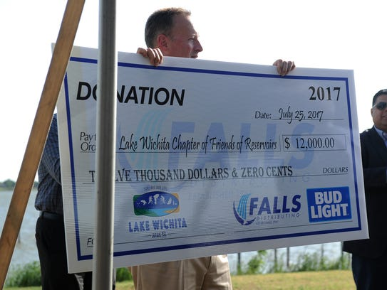 Falls Distributing donated $12,000 to the Lake Wichita