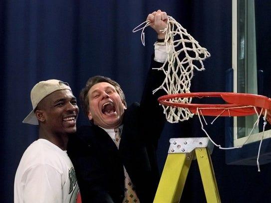Michigan State head coach Tom Izzo and Antonio Smith