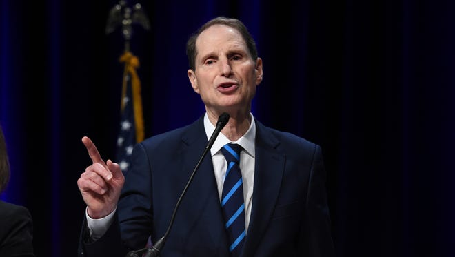 Sen. Ron Wyden, D-Ore., on Sunday urged leaders of the Senate Intelligence Committee to hold a hearing with Attorney General Jeff Sessions in public.