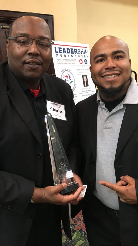 Charles Lee, left, and Jonathon Peterson accept the Unity Award from Leadership Montgomery during a breakfast event Wednesday.