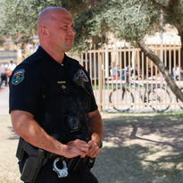 How many police officers already are on Phoenix-area school campuses?