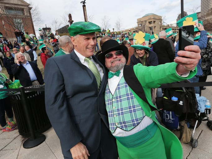 Indianapolis Official Leprechaun Michael Mccrackin takes a photo with Indiana Governor Mike Pence during the Greening of the Canal event held in downtown Indianapolis on Friday, May 14, 2014.