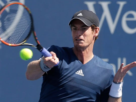Andy Murray, from Great Britain, hits a forehand against Joao Sousa, from Portugal, during a match at the Western & Southern Open tennis tournament, Wednesday, Aug. 13, 2014, in Mason, Ohio. Murray won 6-3, 6-3. (AP Photo/Al Behrman)