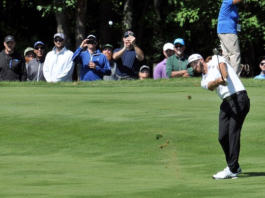 Dustin Johnson of Jupiter, Fla. hits from the second fairway Friday, Sept. 1, 2017 during the first round of the Dell Championship golf tournament at the TPC Boston in Norton, Mass. Johnson finished the round at -5. (Mark Stockwell/The Sun Chronicle via AP)