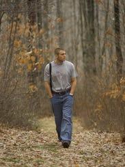 Joel Stephens walks near his home in Tioga, Pennsylvania,