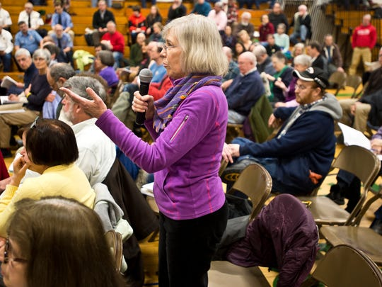 "Husband and wife, Dave and Fran Thomas, hear discussion about Article 8 that would authorize the select board to negotiate a tax agreement as an incentive to redeveloping a property known as the ""Creamery"" during Richmond's Town Meeting at Camel's Hump School Tuesday morning. The article passed."