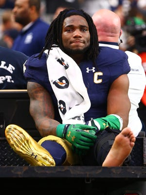 Notre Dame Fighting Irish linebacker Jaylon Smith (9) cries as he is carted off the field after suffering an injury un the first quarter against the Ohio State Buckeyes during the 2016 Fiesta Bowl at University of Phoenix Stadium.