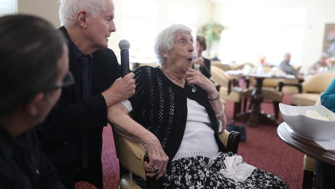 David Kirby, a professor of English atFlorida State University surprises Vivian Allen on her 101st birthday by presenting her with an honorary teaching certificate at the Mulligan Park retirement home on Friday. Allen mentioned always regretting never becoming an English professor and the school stepped in to grant that wish and as they joking noted, start attending the weekly professorial meetings.