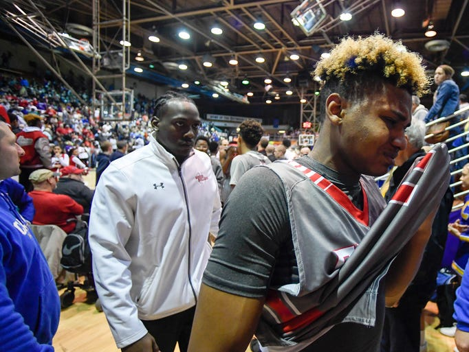 Bosse's Jaidon Hunter (right) reacts as he leaves the