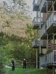 Police cordon off an area behind a Champlain Housing Trust apartment complex on Lake Street in Burlington after a two-year-old child fell from a window on the fourth floor, suffering a broken leg.
