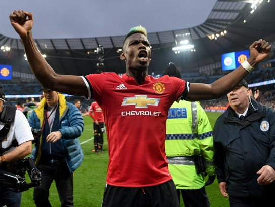 Paul Pogba of Manchester United celebrates victory