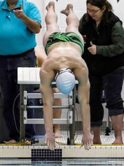 Henry Bauer set four Howell records in the state Division