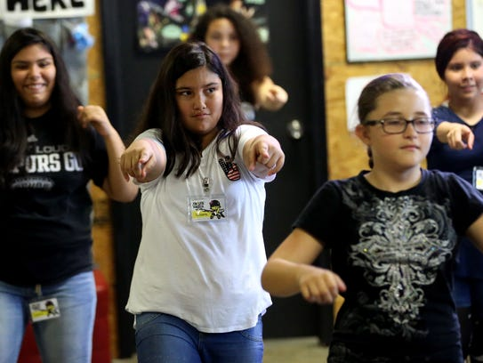 Summer students learn a dance during the Chicas Rock