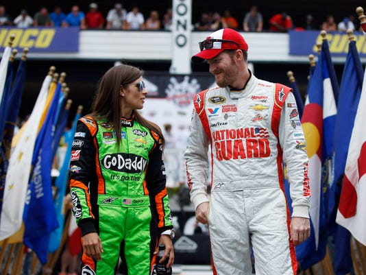 FILE - In this Aug. 3, 2014 file photo, Dale Earnhardt Jr., right, and Danica Patrick talk during driver introductions before the NASCAR Sprint Cup Series auto race at Pocono Raceway in Long Pond, Pa. The relationship between Earnhardt and Patrick will need repairing after a couple of on-track incidents late in the Saturday, July 11, 2015 race at Kentucky Speedway that left both with damaged Chevys, low finishes and a little bad blood between them. (AP Photo/Matt Slocum, File)