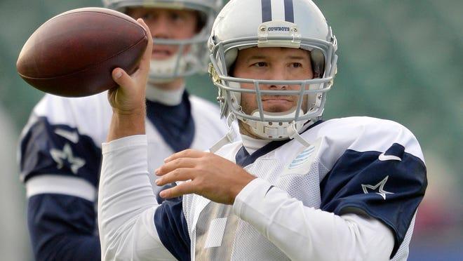 Dallas Cowboys quarterback Tony Romo prepares to throw a ball during a practice sessionon Thursday in London. (AP Photo/NFL UK, Sean Ryan)