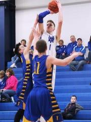 Bearcats senior Elliott Brook shoots the ball.