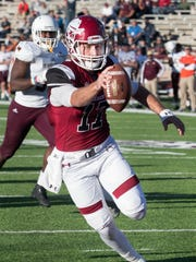 New Mexico State quarterback Tyler Rogers extends the football across the goal line for a NMSU touchdown Saturday afternoon at Aggie Memorial Stadium.