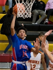 Las Cruces High's Shae Hernandez drives the baseline