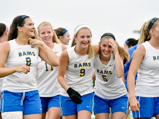 Kennard-Dale lacrosse players return to their bench after winning the PIAA District 3 girls lacrosse championship game Thursday, May 26, 2016, at Hersheypark Stadium. Kennard-Dale defeated Exeter Township 12-8 to become the first YAIAA team to win the title.