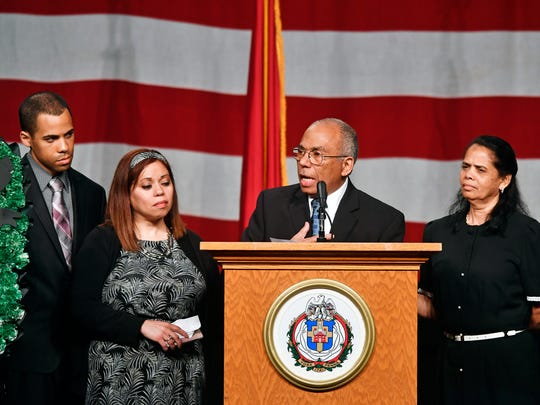 Alix Sable speaks at the memorial service for his son, York City Police Officer Alex Sable. At far left are Alix Sable's son Andrew Sable and daughter Priscila Sable-Cuthbertson; at far right is Alix Sable's wife and Alex's mother, Arelis.