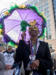 Revelers take part in the Mardi Gras Block Party &