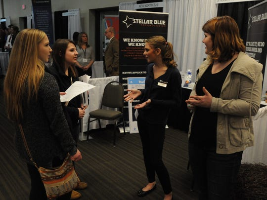 Austyn Sippl and Harmone Erhard of Oshkosh North take part in the  scavenger hunt at the Business Expo for the Innovation Fair for high school students.  They interviewed Shelby Milock of Stellar Blue Technologies and Kayce Anderson of the House of Flowers during the hunt.