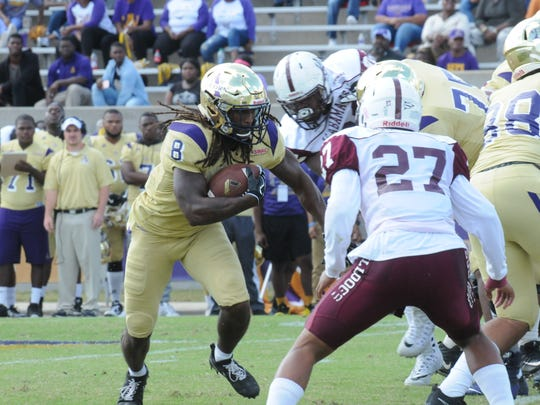 Running back De'Lance Turner runs through the hole as Alcorn State beats Alabama A&M.