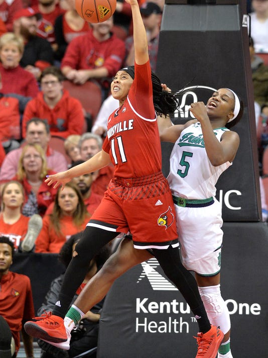 Louisville guard Arica Carter (11) grabs a rebound away from Notre Dame guard Jackie Young (5) to grab a rebound during the second half of an NCAA college basketball game, Thursday, Jan. 11, 2018, in Louisville, Ky. (AP Photo/Timothy D. Easley)