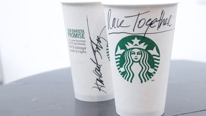 Howard Schultz, CEO and chairman of Starbucks, has signed a Starbucks cup with the words Race Together. Starbucks baristas have started writing the words Race Together on cups to start a conversation with customers about race relations in America.