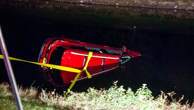 An SUV had to be pulled out of pond on Holt Road in Webster on Friday.