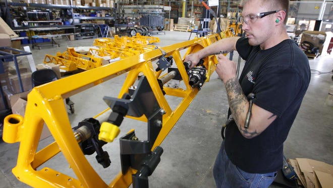 Jeremy Sosbe works on a boom assembly Aug 26, 2009, at the Hagie Manufacturing Company in Clarion.
