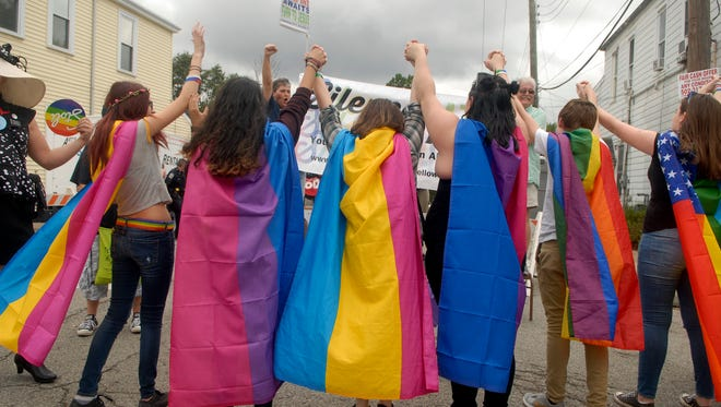 Brown High School students wore rainbow flags as capes at the second annual Louisville Pride Festival on Bardstown Road on Saturday afternoon. Sept. 17, 2016