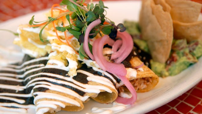 Enchiladas con huevo ($11.99)  at Con Huevos on Frankfort Ave. Oct. 04, 2016