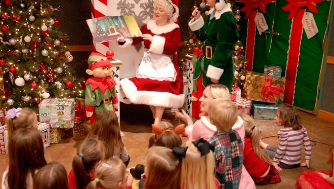 Mrs. Claus reads a story to children at the Santa Safari at the Louisville Zoo Saturday.  Dec. 17, 2016