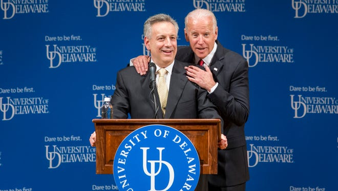 Former Vice President Joe Biden pats University of Delaware President Dr. Dennis Assanis on the shoulder during a ceremonial opening of the new Biden Institute at the University of Delaware's Roselle Center for the Arts in Newark on Monday afternoon.