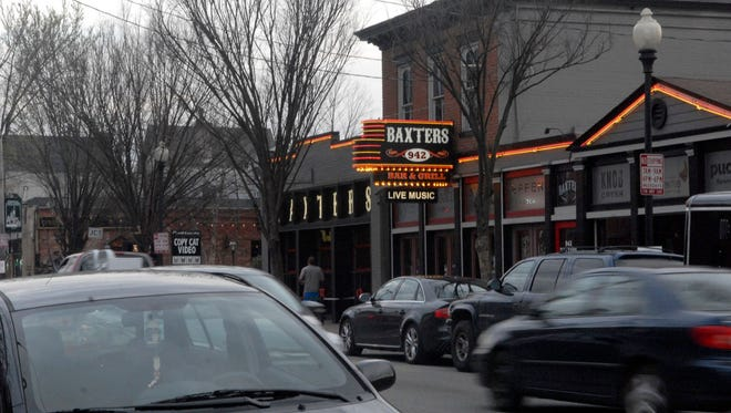 Traffic congestion on Baxter Avenue in front of Baxter's 942 Bar & Grille.