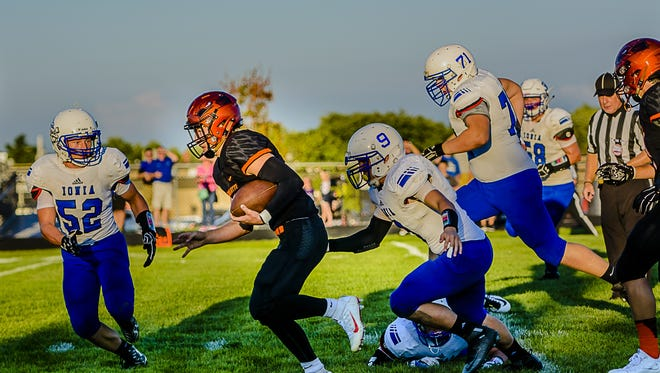 Charlotte quarterback Dom Ghiardi, center, is one of six returning starters on offense for the Orioles, who are entering the CAAC Red this season.