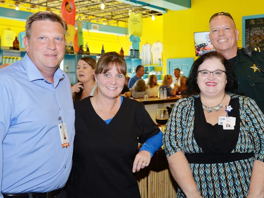 David Forest, left, Cindy Sheelar, Landy Tiffany and Troy Church at the Chili Cook-Off kick-off party at Islamorada Beer Co. Brewery in Fort Pierce.