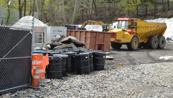 Crews work to remediate the site of a planned Marriott SpringHill Suites hotel on Marbledale Road.