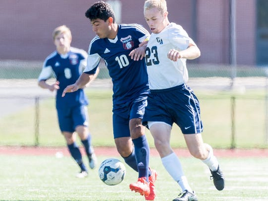 Kaleb Hurley (23) of Greencastle-Antrim and Rene Quintanilla (10) of Chambersburg contest the ball on Saturday during the Trojans' 4-2 win.