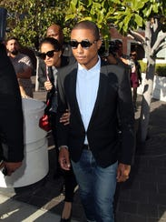 Pharrell Williams outside the courthouse building.