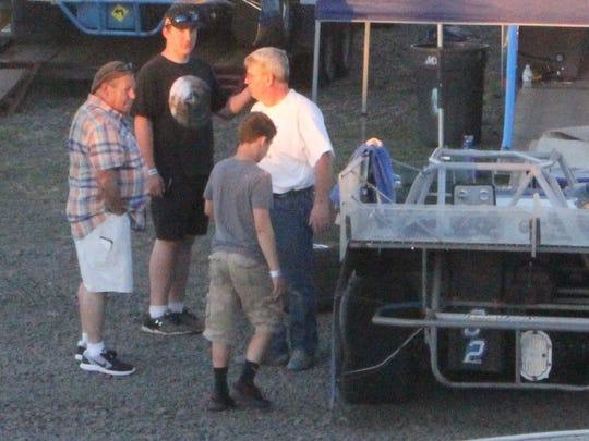 Gil Pickett (white shirt) talks after a race at Willamette Speedway.