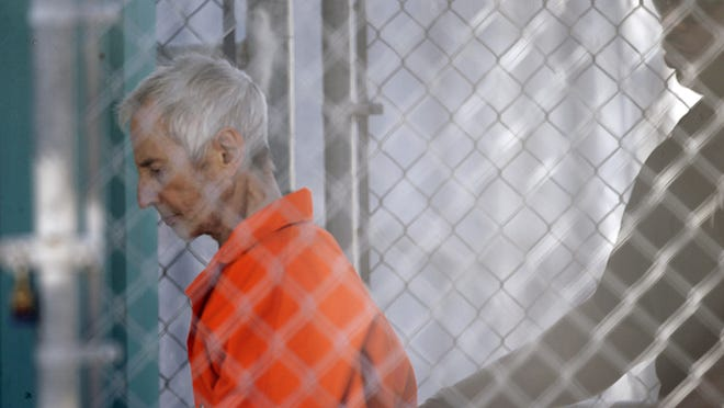 Robert Durst is escorted into Orleans Parish Prison after his March 17 arraignment in New Orleans.