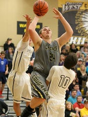 Cascade's Alec Raney (24) shoots past Philomath's Kevin Rhodes (10) during their game on Friday, Feb. 6 , 2015, in Philomath, Ore.