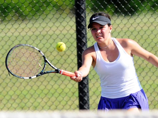 Wylie's Analeah Elias looks the ball onto her racket