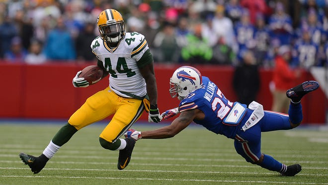 Green Bay Packers running back James Starks (44) gets by Buffalo Bills safety Duke Williams (27) in the first quarter during Sunday's game at Ralph Wilson Stadium in Orchard Park, N.Y.