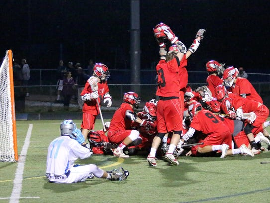 Champlain Valley players celebrate the final horn of