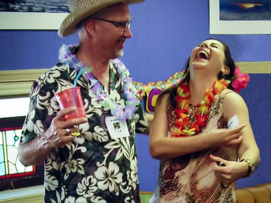 Greg Nauman and Roxana Grimes laugh during a Hawaiian-themed murder mystery night at Escape Games Live in York on a recent Saturday night.