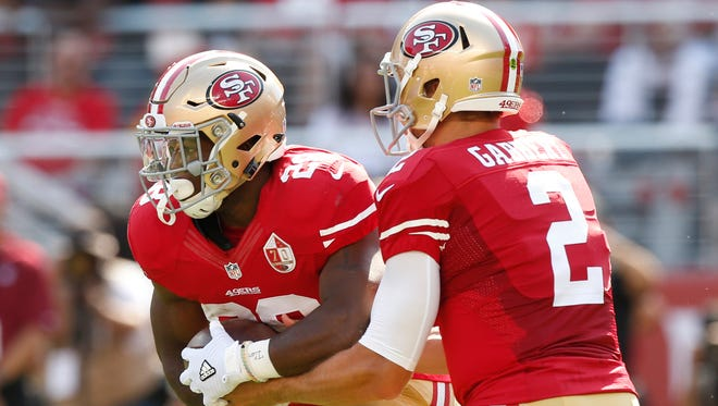 The 49ers enter the 2016 season counting on RB Carlos Hyde, left, and QB Blaine Gabbert.